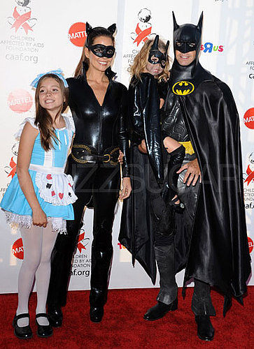 Alice in Wonderland, Catwoman, and Batman David Charvet and Brooke Burke looked good in matching store-bought Batman costumes, while their daughter went as Alice.