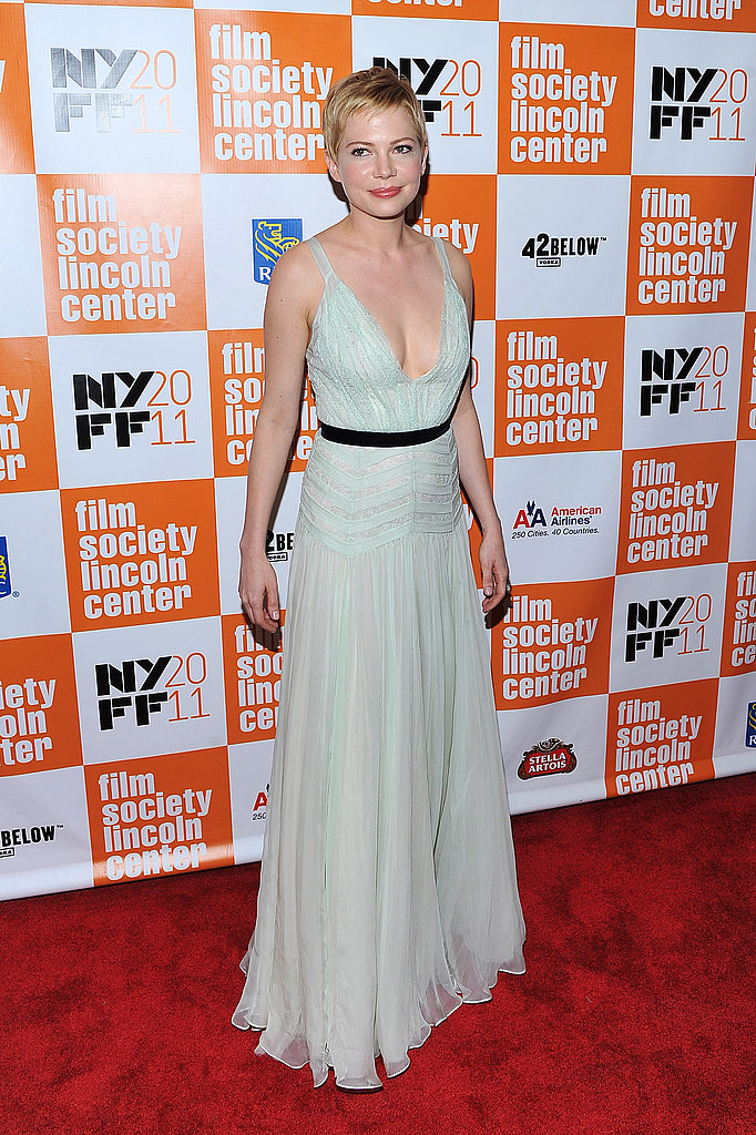 Michelle Williams in a long white dress.