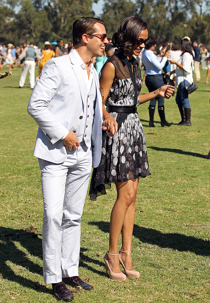 Zoe Saldana was escorted across the lawn at the Veuve Clicquot Polo Classic.
