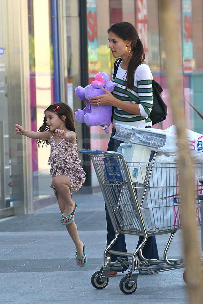 Suri Cruise jumps for joy while out shopping with mom Katie Holmes!