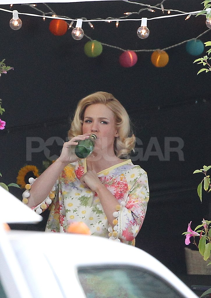 January Jones sipped a San Pellegrino on set.