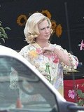 January Jones adjusted her costume on the Mad Men set.