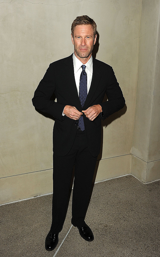 Aaron Eckhart buttoned his suit jacket on his way into a private dinner.