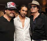 Johnny Depp kept his hat on while hanging with artists Domingo Zapata and Jordi Molla.