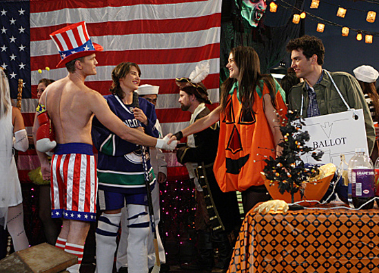 Neil Patrick Harris as Barney, Cobie Smulders as Robin Scherbatsky, Katie Holmes as Naomi, and Josh Radnor as Ted on How I Met Your Mother. Photo courtesy of CBS