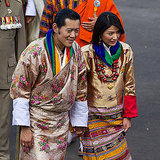 King Jigme Khesar Namgyel Wangchuck and Queen Ashi Jetsun Pema hold hands.