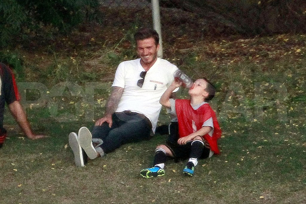 David Beckham watched as his son Cruz drank water after a soccer practice.