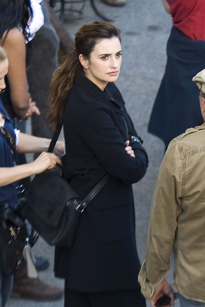 Penelope Cruz arrived to work wearing a dark coat.
