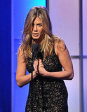 Jennifer Aniston let her locks fly free during her speech.
