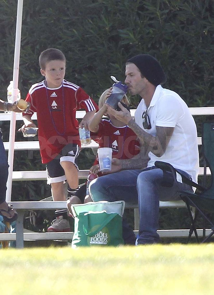 David Beckham on the sidelines with Romeo and Cruz.