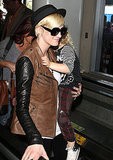 Ashlee Simpson holds onto Bronx Wentz at LAX.