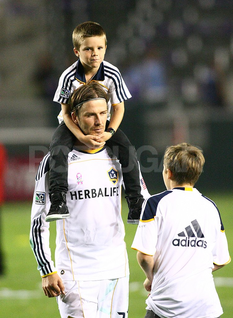 Cruz Beckham took a ride on dad, David Beckham's shoulders.