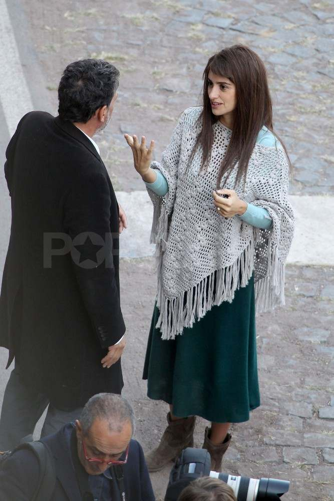 Penelope Cruz in a poncho on set.