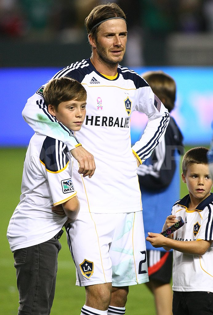 David Beckham wrapped his arm around Brooklyn.
