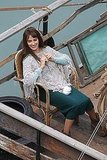 Penelope Cruz wears a poncho on set in Rome.