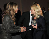 Jennifer Aniston and Reese Witherspoon held hands at Elle's Women in Hollywood event.