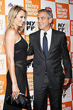 George Clooney lead Stacy Keibler were affectionate on the red carpet.