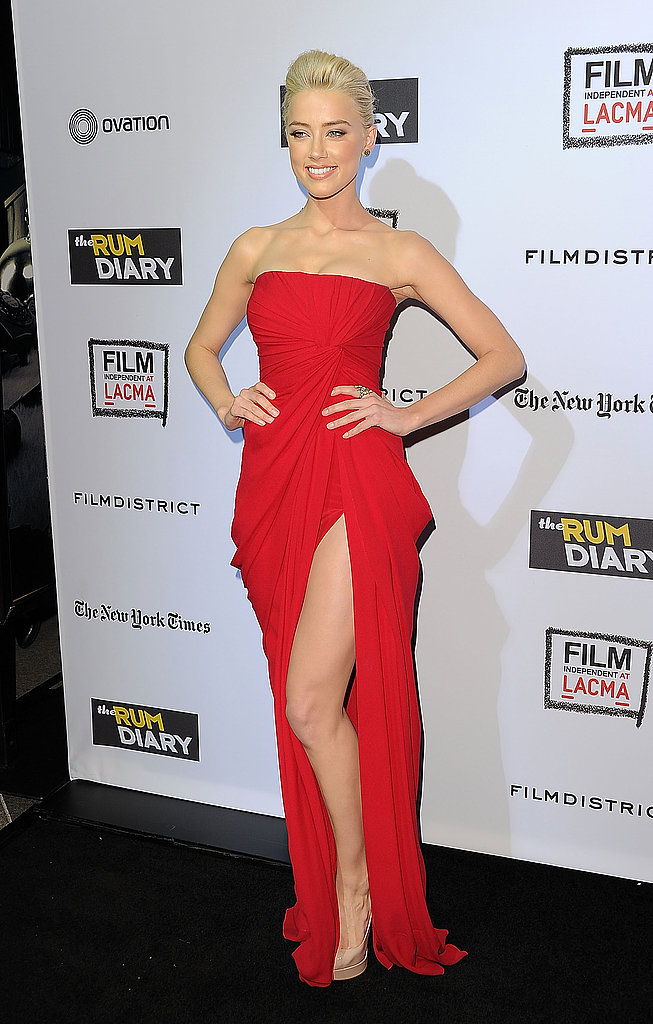 We loved Amber in this ultrasexy red strapless dress by Elie Saab at The Rum Diary screening in October 2011.