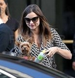 Miranda Kerr carried her dog and a juice.