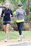 Reese Witherspoon runs with a friend.