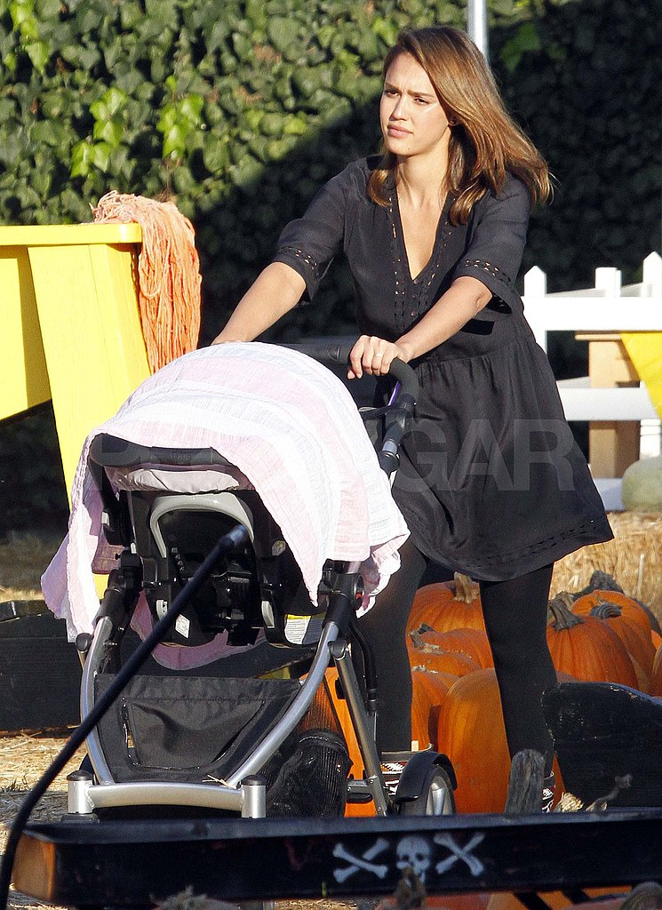 Jessica Alba pushes Haven around Mr. Bones pumpkin patch.