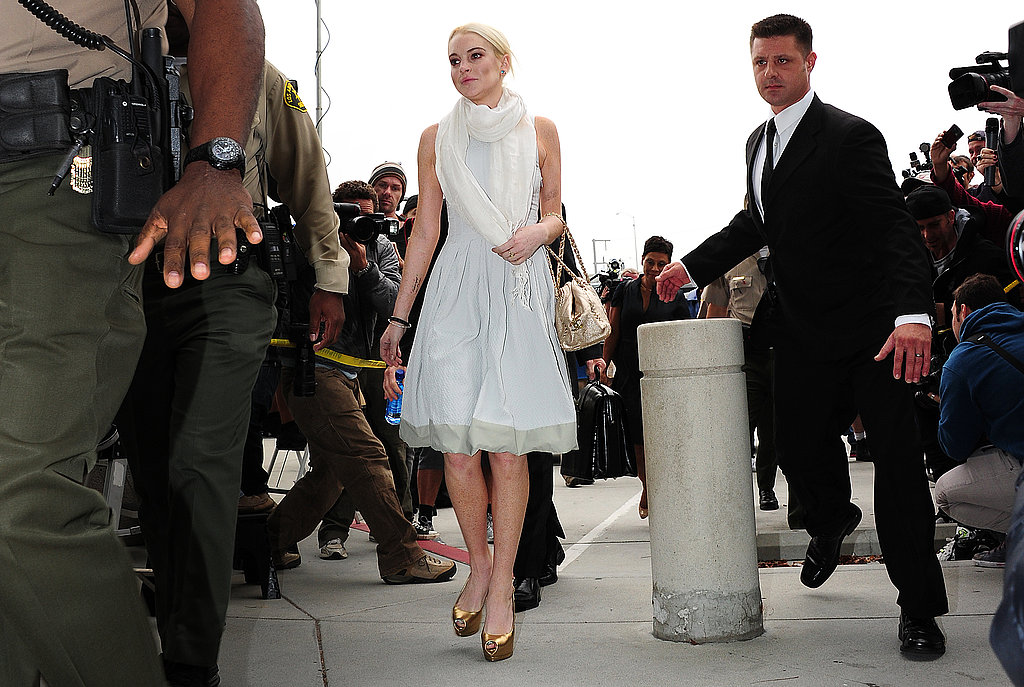 Lindsay Lohan wore gold heels to her trial.