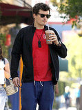 Orlando Bloom took a sip of his drink.