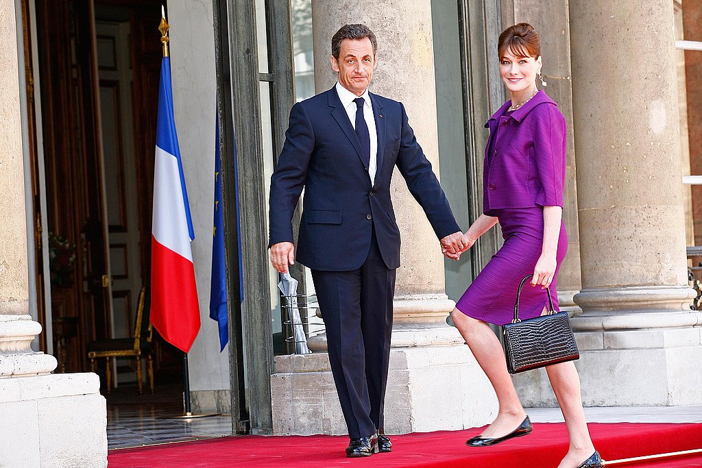 Carla Bruni and Nicolas Sarkozy arrive in the courtyard of the Élysée for the garden party following the Bastille Day parade in 2008.