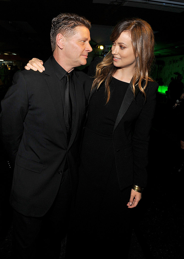 Andrew Niccol and Olivia Wilde had a chat at the In Time premiere party.