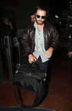 Robert Pattinson carrying his luggage in Paris.