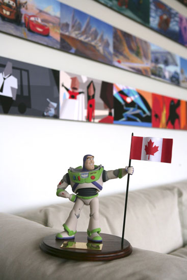 Buzz Lightyear displays national pride in front of Pixar storyboard art.   Images courtesy of Pixar