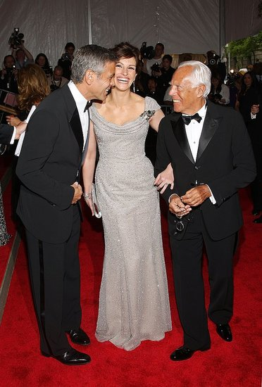 Julia Roberts flashed her famous smile with George Clooney and Giorgio Armani at the Costume Institute Gala in 2008.