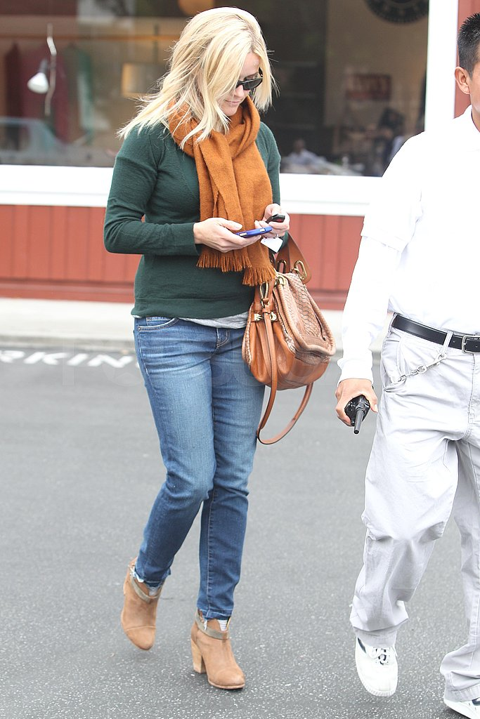 Reese wore cute, short boots with her skinny jeans.