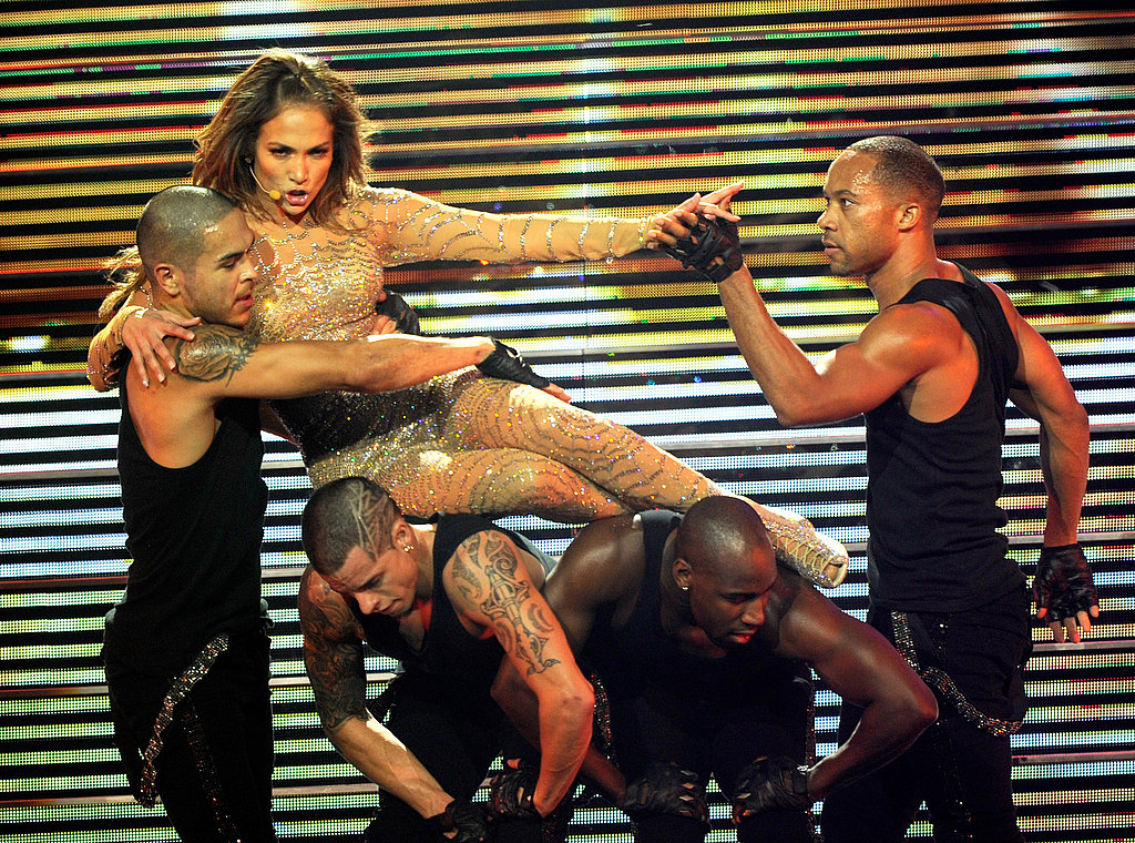 Jennifer Lopez lying across her dancers.