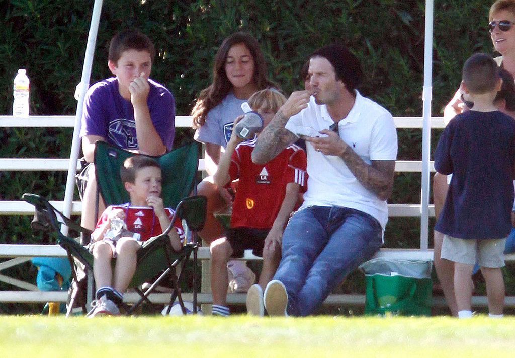 David, Romeo, and Cruz Beckham had a seat and a snack on the sidelines of Brooklyn's game.