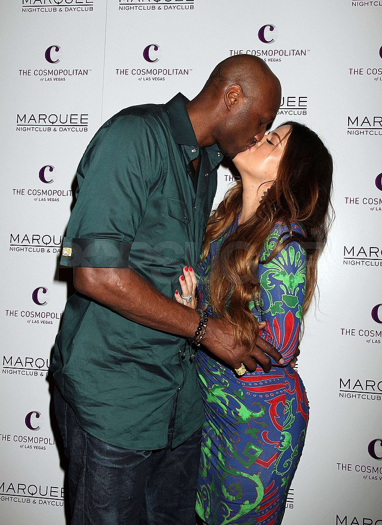 Khloe Kardashian and Lamar Odom kissed on the carpet.