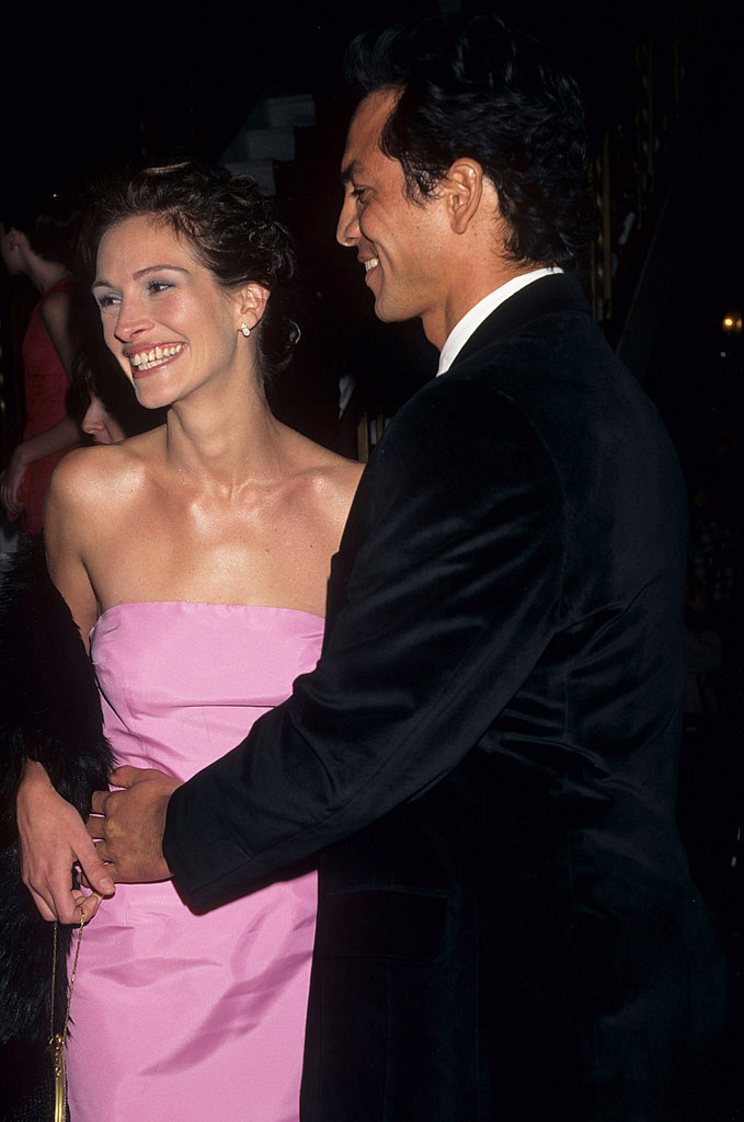 Julia Roberts smiled in a bubblegum-pink dress at the premiere of Stepmom in 1998 with then-boyfriend Benjamin Bratt.