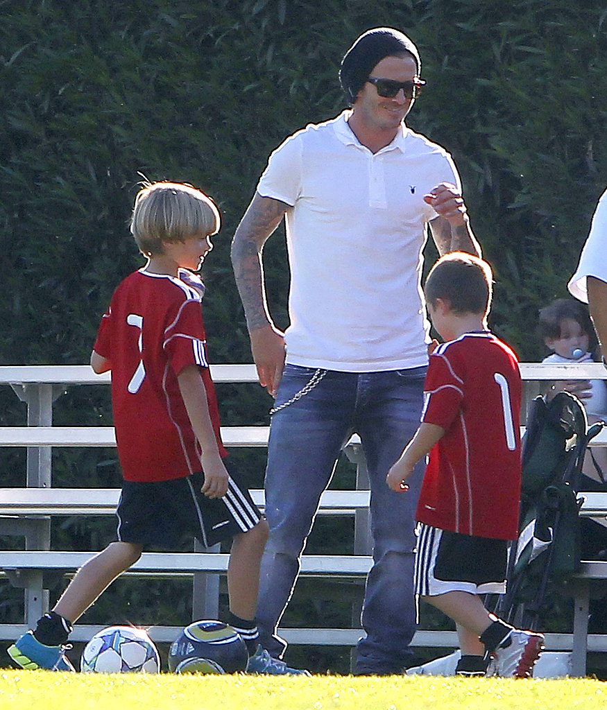 David Beckham played a mini game of soccer on the sidelines with Romeo and Cruz.