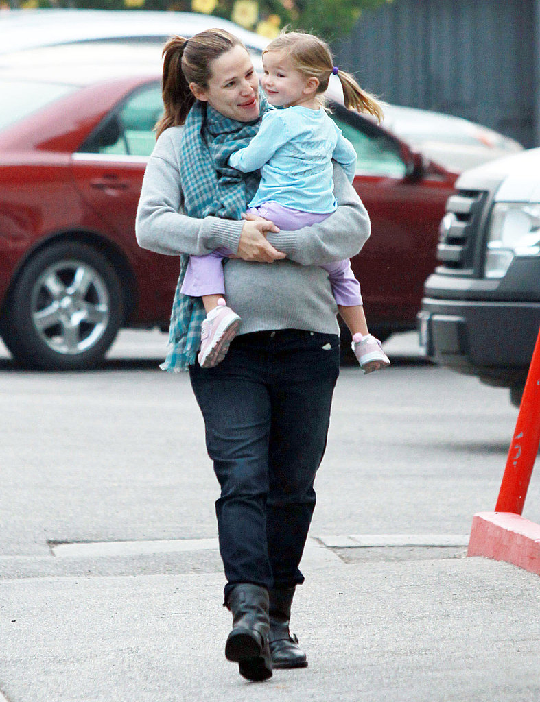 Seraphina Affleck cuddled close to her mom.