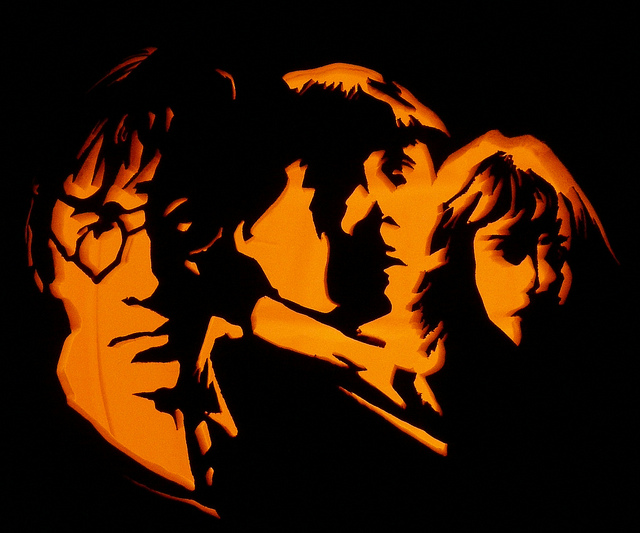 Harry, Ron, and Hermione get the pumpkin treatment.