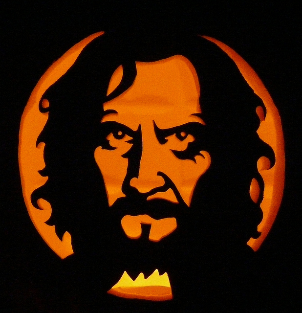 Sirius Black looks ever so serious with a candle behind his face.