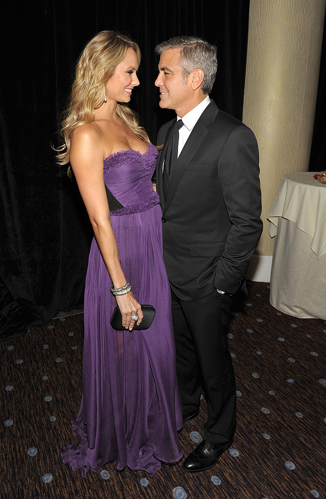 George Clooney and girlfriend Stacy Keibler stared into each other's eyes at the Hollywood Film Awards.