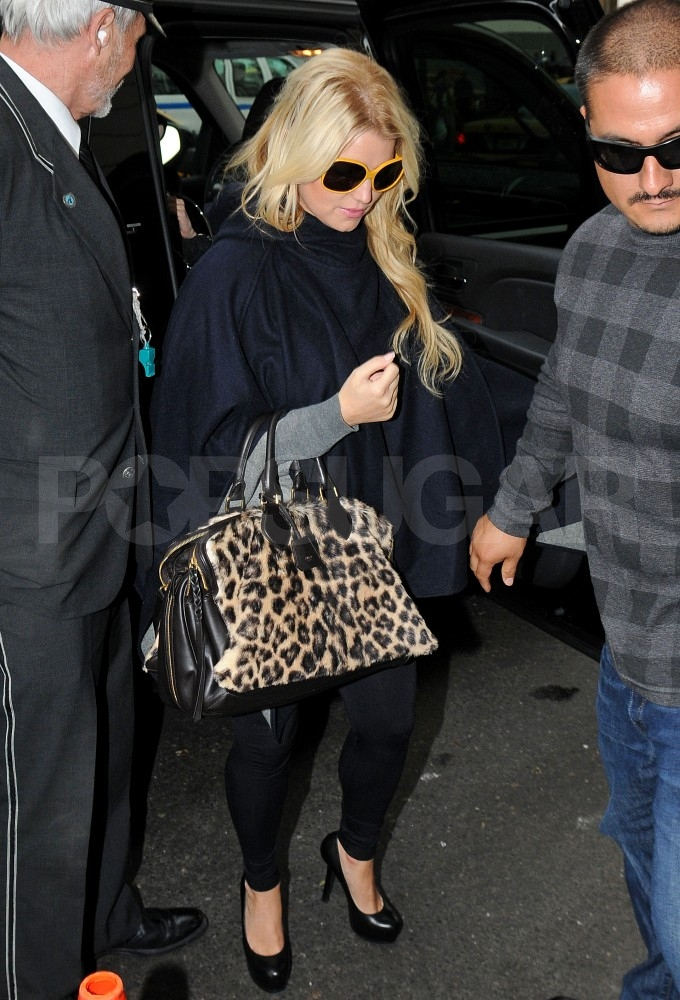 Jessica Simpson was escorted from her car in NYC.