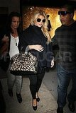 Jessica Simpson carrying an animal-print bag.