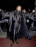 Elle Macpherson is cloaked and ready to party at a Halloween masquerade ball in 1995.