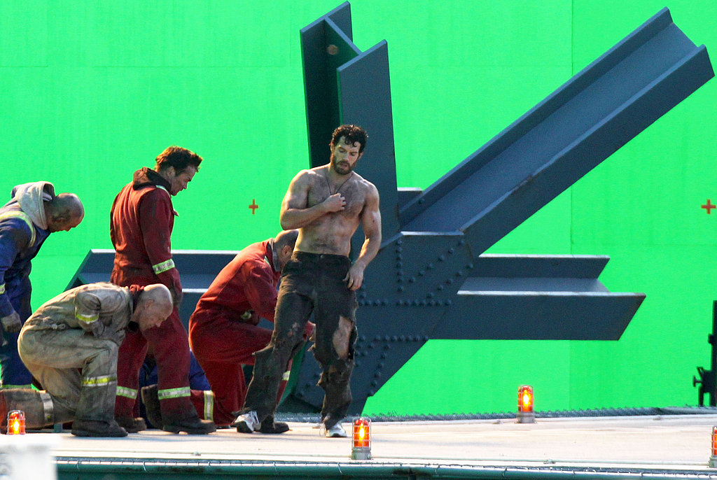 Shirtless Henry Cavill wore torn pants on the set of Man of Steel.