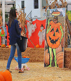 Alessandra Ambrosio watched Anja Mazur pose as a pumpkin.