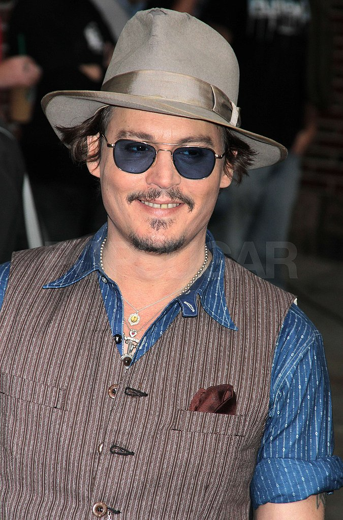 Johnny Depp flashed a smile as he arrived.