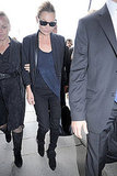 Kate Moss is a professional at styling the edgy-chic look. Take a cue from the master and add a hint of the trend to your look with just a leather lapel and deep black and navy hues.