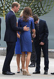 Prince William touched Kate's back as they arrived in Quebec City in 2011.